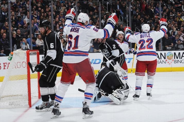 Rick Nash (61) and Dan Boyle (22) celebrate Marty St. Louis' goal (Photo: Andrew D. Bernstein/Getty Images)